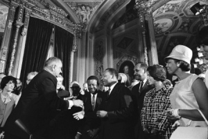 President Lyndon Johnson and Dr. Martin Luther King, Jr., at the signing of the Civil Rights Act.
