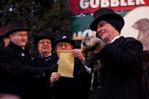 Group photo including man holding Punxsutawney Phil